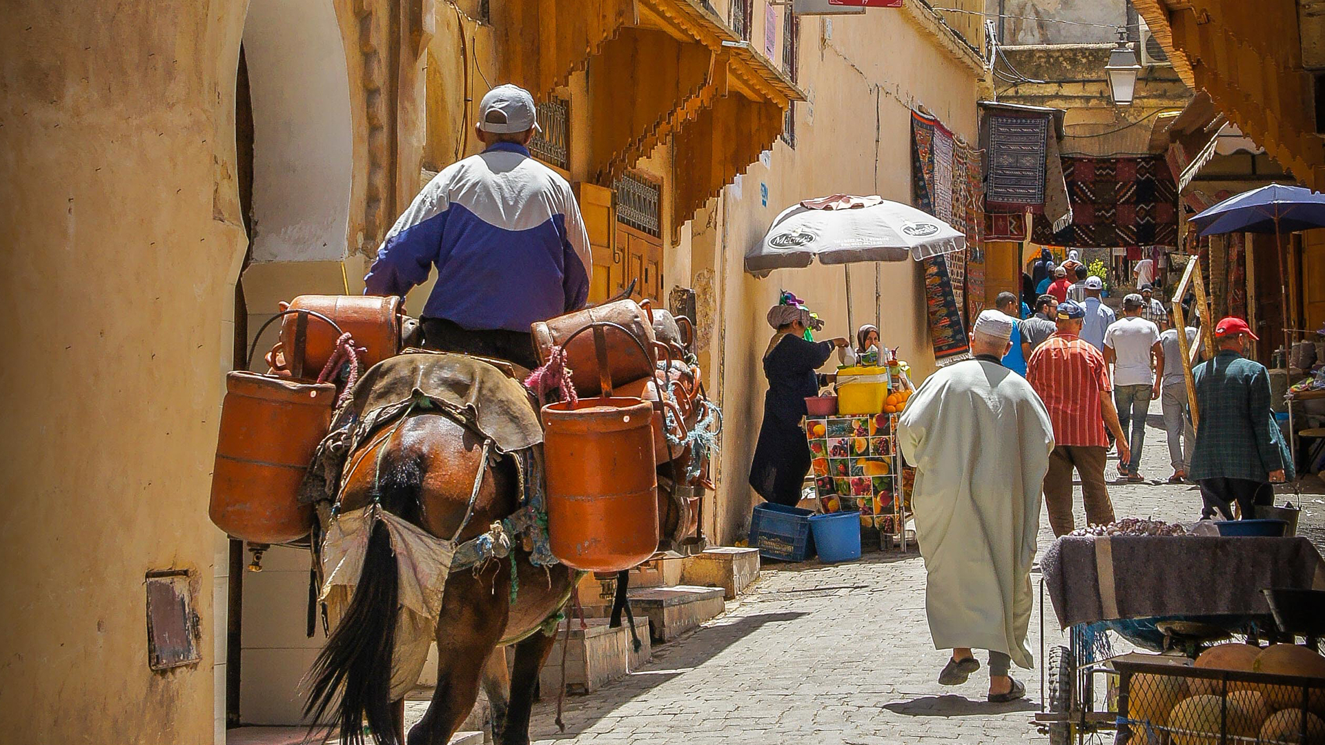 A merchant bringing his wares to market in Marrakech